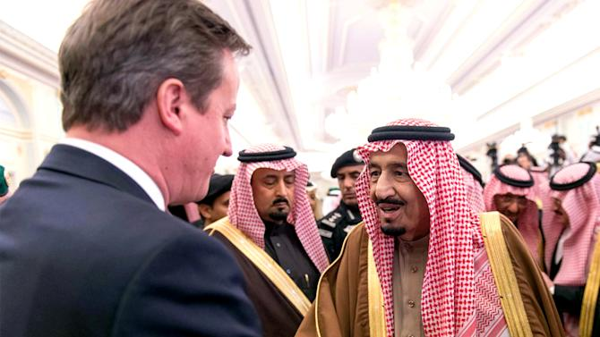 In this photo provided by the Saudi Press Agency, newly enthroned Saudi King Salman, right, greets the Prime Minister of the United Kingdom, David Cameron, left, in the king's dewaniya, a traditional Arab reception area to receive guests, where Cameron offers condolences for late King Abdullah, in Riyadh, Saudi Arabia, late Saturday, Jan. 24, 2015. Heads of state and royals from around world will be visiting Saudi Arabia over the coming days to pay their respects in meetings with Saudi royals. Powerful heads of tribes, as well as average Saudi citizens, will also meet the new king to give their condolences and express pledges of loyalty to him. (AP Photo/SPA)
