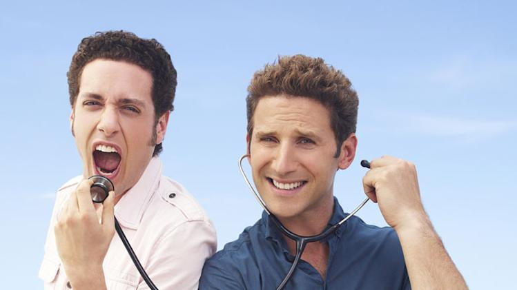 "Paulo Costanzo as Evan Lawson and Mark Feuerstein as Dr. Hank Lawson on ""Royal Pains."""