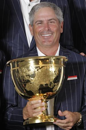 United States team captain Fred Couples poses with the Presidents Cup after the U.S. won the Presidents Cup golf tournament at Muirfield Village Golf Club Sunday, Oct. 6, 2013, in Dublin, Ohio. (AP Photo/Jay LaPrete)
