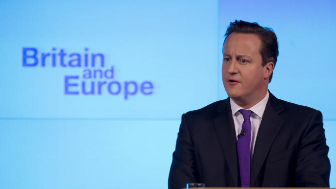 """Britain's Prime Minister David Cameron makes a speech on having a referendum on staying in the European Union in London, Wednesday, Jan. 23, 2013.  Cameron said Wednesday he will offer British citizens a vote on whether to leave the European Union if his party wins the next election, a move which could trigger alarm among fellow member states.  He acknowledged that public disillusionment with the EU is """"at an all-time high,"""" using a long-awaited speech in central London to say that the terms of Britain's membership in the bloc should be revised and the country's citizens should have a say. (AP Photo/Matt Dunham)"""