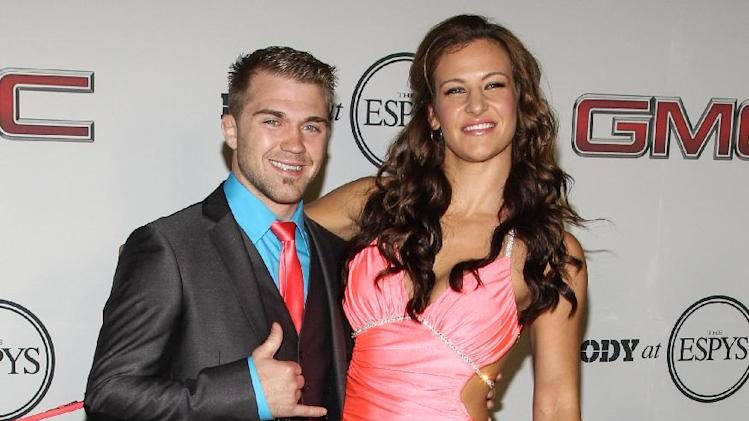 UFC fighter Miesha Tate (R) at the Body at ESPYS Party sponsored by Hennessy V.S on July 16, 2013 at Lure in Los Angeles, CA. (Photo by Paul A. Hebert/Invision for Hennessy/AP Images)