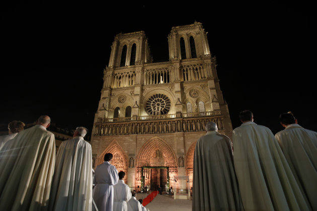 Religious dignitaries stand in front of Paris' Notre Dame Cathedral as part of a ceremony for its 850th anniversary, Wednesday, Dec. 12, 2012. Dignitaries, tourists and Parisians gathered in the thous