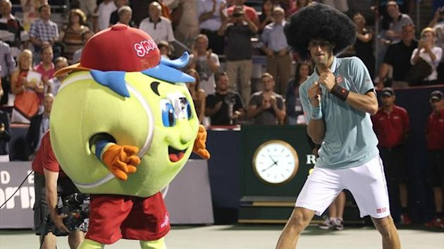 Novak Djokovic of Serbia dons a wig and dances following his win over Denis Istomin of Uzbekistan at the Rogers Cup (Reuters)