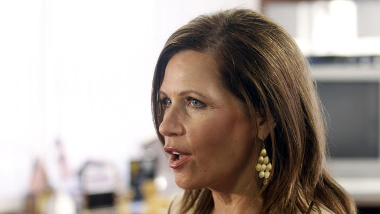 Republican presidential candidate Rep. Michele Bachmann, R-Minn., answers questions regarding illegal immigration issues plaguing Arizona during a news conference prior to meeting with Maricopa County Sheriff Joe Arpaio at his office Wednesday, Sept. 14, 2011, in Phoenix. (AP Photo/Paul Connors))