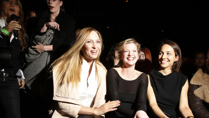 Actresses Uma Thurman and Gretchen Mol attend the Donna Karan Autumn/Winter 2013 collection during New York Fashion Week