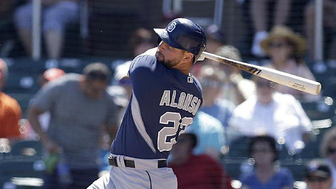 San Diego Padres first baseman Yonder Alonso swings for a single off Arizona Diamondbacks' Chase Anderson in the first inning of a spring training exhibition baseball game Thursday, March 26, 2015, in Scottsdale, Ariz. (AP Photo/Ben Margot)