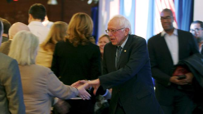 U.S. Democratic presidential candidate Sanders shakes hands with potential supporters after speaking at the New Hampshire Democratic Party's Jefferson Jackson dinner in Manchester