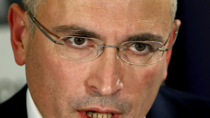 Mikhail Khodorkovsky speaks during a news conference in Berlin, Sunday, Dec. 22, 2013. The former oil baron and prominent critic of Russian President Vladimir Putin, Mikhail Khodorkovsky, was reunited with his family in Berlin on Saturday, a day after being released from a decade-long imprisonment in Russia. (AP Photo/Michael Sohn)