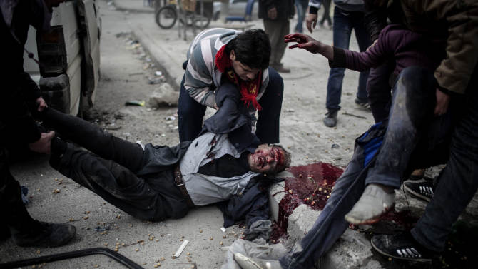 EDS NOTE: GRAPHIC CONTENT - A man helps carry the dead boy of a civilian killed after a mortar attack in the Saif al-Dawlah neighborhood of Aleppo, Syria, Sunday, Jan. 13, 2013. The revolution against the Syrian regime started in March 2011 with peaceful protests but morphed into a civil war that has killed more than 60,000 people, according to a recent United Nations estimate. (AP Photo/Andoni Lubaki)