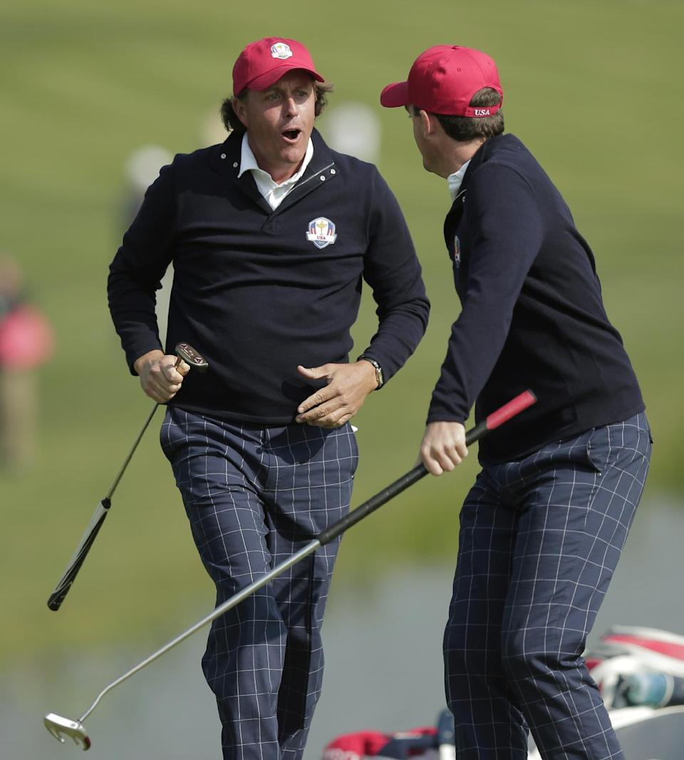 USA's Phil Mickelson and Keegan Bradley celebrate after winning their foursomes match on the 15th hole at the Ryder Cup PGA golf tournament Friday, Sept. 28, 2012, at the Medinah Country Club in Medinah, Ill. (AP Photo/Charlie Riedel)