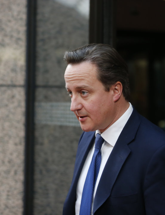 British Prime Minister David Cameron leaves the building after a bilateral meeting at an EU summit in Brussels on Thursday, Nov. 22, 2012. EU leaders begin what is expected to be a marathon summit on