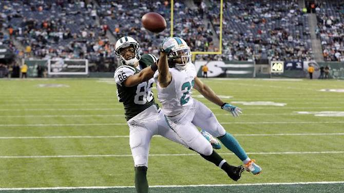 Grimes signs 4-year deal to remain with Dolphins