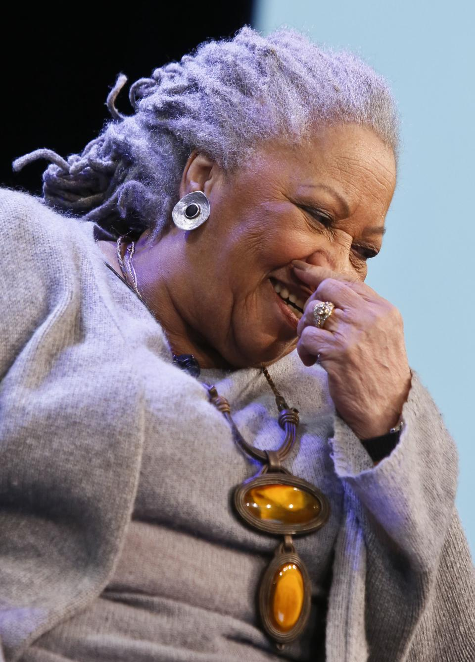 "Author Toni Morrison laughs during an interview about her latest book ""Home,"" on Google's online series, ""Authors At Google,"" on Wednesday, Feb. 27, 2013 in New York. (AP Photo/Bebeto Matthews)"
