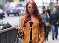 PHOTO: Amy Childs Keeps New Breasts Under-wraps In First Outing Since Procedure