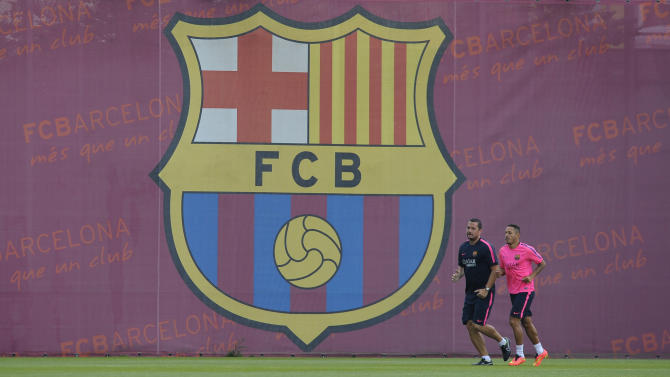 FC Barcelona's Adriano Correia, right, runs during a training session at the Sports Center FC Barcelona Joan Gamper in San Joan Despi, Spain, Friday, July 25, 2014. (AP Photo/Manu Fernandez)