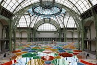 "View of the creation of contemporary artist Daniel Buren in the Grand Palais during the opening of ground-breaking Monumenta exhibit in Paris, Wednesday May 9, 2012. Monumenta, the hugely-popular annual installation project that's in its fifth year, dares an artist of international statue to ""move into"" the nave of one of the French capital's most monumentus buildings, and own it. (AP Photo/Francois Mori)"
