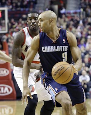 Charlotte Bobcats guard Gerald Henderson, right, drives past Portland Trails Blazers guard Wesley Matthews during the first half of an NBA basketball game in Portland, Ore., Thursday, Jan. 2, 2014. (AP Photo/Don Ryan)