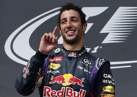 Winner Red Bull Formula One driver Ricciardo of Australia celebrates on the podium after the Hungarian F1 Grand Prix at the Hungaroring circuit, near Budapest