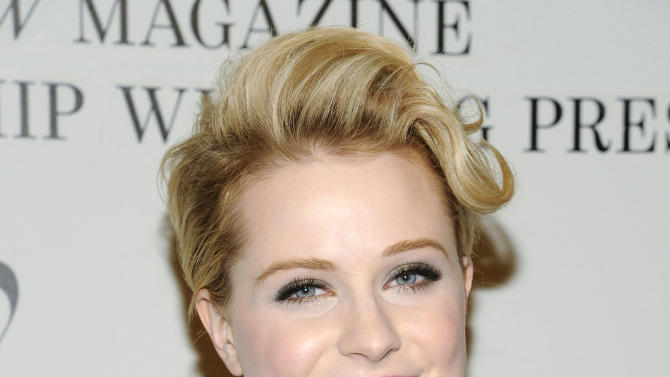 """FILE - This Feb. 14, 2012 file photo shows actress Evan Rachel Wood at the unveiling of """"The Ever Changing Face of Beauty"""" video installation by fashion photographer Solve Sundsbo at the Park Avenue Armory in New York. Wood's publicist Amanda Silverman confirmed Friday, Jan. 11, 2013, that she and husband Jamie Bell are expecting their first child and says they're """"thrilled."""" The couple first dated in 2005 but broke up the following year. They reunited in 2011 and got married last year. (AP Photo/Evan Agostini, file)"""