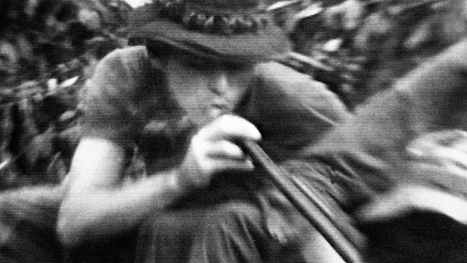 """FILE - In this file still image made from Nov. 13, 1970, video, soldiers in fire support base Aries, a small clearing in the jungles of War Zone D, 50 miles from Saigon, smoke marijuana using the barrel of a shotgun they nicknamed """"Ralph"""" to get high. On the occasion of  """"Legalization Day,"""" Thursday, Dec. 6, 2012, when Washington's new law takes effect, AP takes a look back at the cultural and legal status of the """"evil weed"""" in American history. (AP Photo/Jim Wells, File)"""