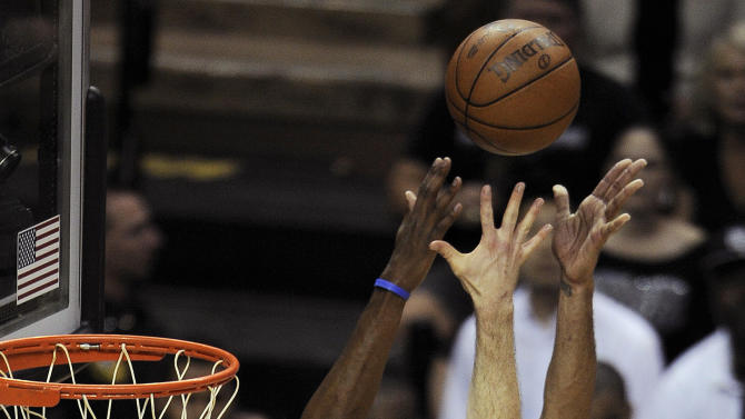 Oklahoma City Thunder's Kevin Durant (35) and Nick Collison (4) defend against a shot from San Antonio Spurs center Tim Duncan (21) during the first half of Game 1 in their NBA basketball Western Conference finals playoff series, Sunday, May 27, 2012, in San Antonio. (AP Photo/Darren Abate)