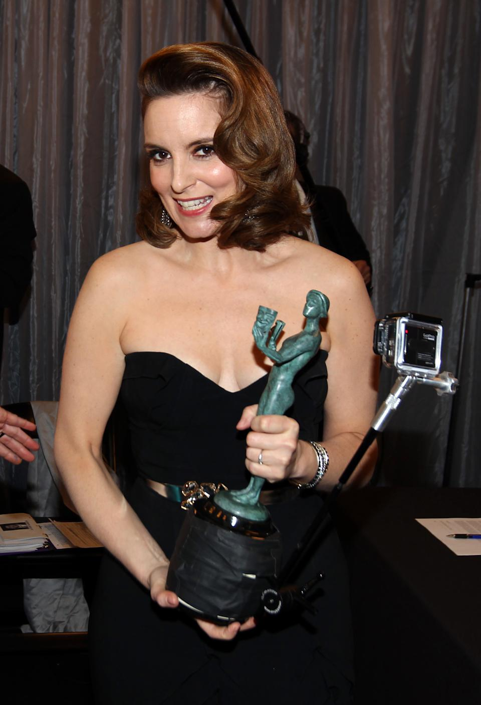 "Tina Fey is seen backstage with the award for outstanding female actor in a comedy series for ""30 Rock"" at the 19th Annual Screen Actors Guild Awards at the Shrine Auditorium in Los Angeles on Sunday Jan. 27, 2013. (Photo by Matt Sayles/Invision/AP)"