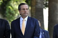 The leader of Greece's conservative New Democracy party, Antonis Samaras, pictured on May 13, has said remarks attributed to German Chancellor Angela Merkel, that the country hold a referendum on euro membership, were regrettable