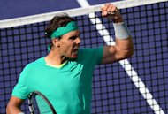 Rafael Nadal of Spain celebrates winning a point against Juan Martin Del Potro of Argentina in Indian Wells, California, during the men's BNP Paribas Open final, on March 17, 2013. On Sunday, Nadal begins his bid for a ninth successive Monte Carlo Masters title