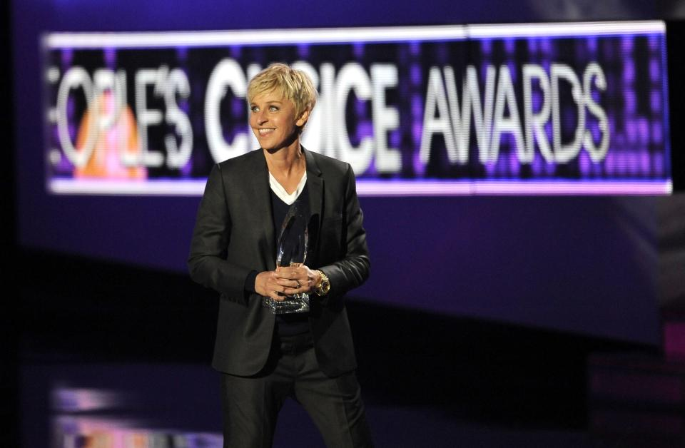 "Ellen Degeneres accepts the award for favorite daytime TV host for ""The Ellen Degeneres Show"" during the People's Choice Awards on Wednesday, Jan. 11, 2012 in Los Angeles. (AP Photo/Chris Pizzello)"