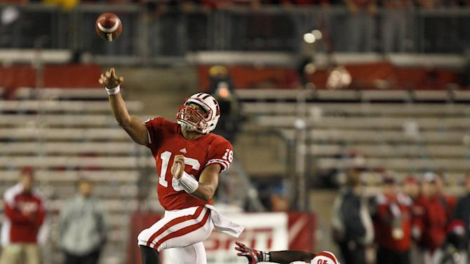 Wisconsin quarterback Russell Wilson (16) passes against Nebraska defensive end Eric Martin (46) during the first half of an NCAA college football game Saturday, Oct. 1, 2011, in Madison, Wis. (AP Photo/Andy Manis)