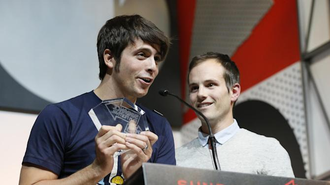 "Documentary subject Rocky Braat, left, and director Steve Hoover accept the Grand Jury Prize: U.S. Documentary for ""Blood Brother"" during the 2013 Sundance Film Festival Awards Ceremony on Saturday, Jan. 26, 2013 in Park City, Utah. (Photo by Danny Moloshok/Invision/AP)"