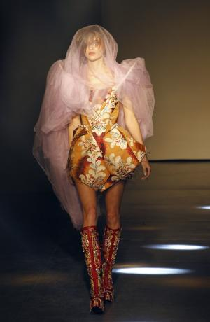 A model wears a creation by designer Vivienne Westwood as part of the Fall-Winter, ready-to-wear 2013 fashion collection, during Paris Fashion week, Saturday, March 3, 2012. (AP Photo/Christophe Ena)