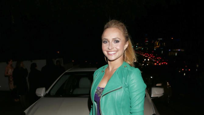 Hayden Panettiere arrives in a Cadillac XTS to the W Magazine's Best Performances and Golden Globe Awards Party Presented by Cadillac, on Friday, January, 11, 2013 in Los Angeles. (Photo by Todd Williamson/Invision for Cadillac/AP Images)