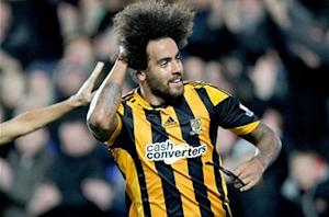 Manchester City goes on top and Huddlestone gets a haircut: The Premier League in pictures