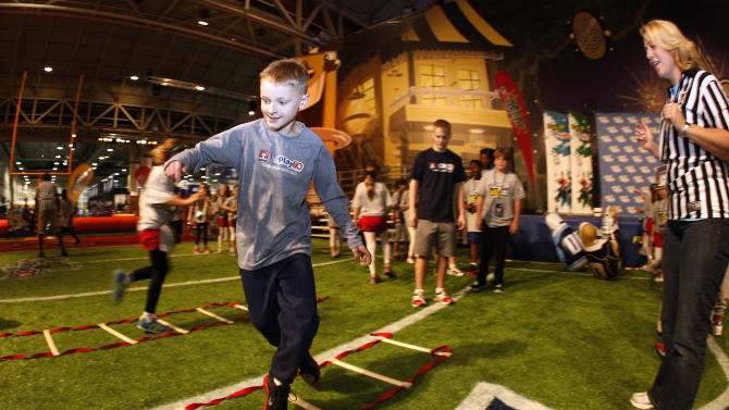 Hunter Paulin, winner of the NFL Play 60 Super Bowl Contest presented by Quaker, works through a drill at the Quaker's NFL Experience in New Orleans on Wednesday, Jan. 30, 2013. (Jonathan Bachman / AP Images for Quaker Oats)