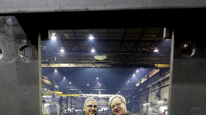 Cedar Fair CEO Matt Ouimet, left, tours the Clermont Steel Fabricating plant with plant representative Bob Mampe, Wednesday, Jan. 9, 2013, in Batavia, Ohio. Ouimet is encouraged about the company's future and the industry and believes one key is keeping people happy. He said the company's new dramatic roller coaster under construction in southwest Ohio will help achieve that goal. (AP Photo/Al Behrman)