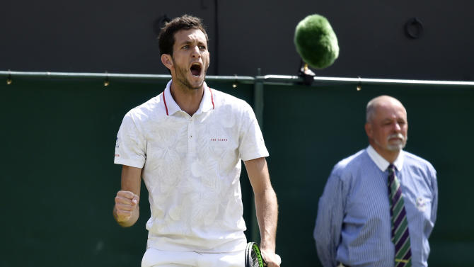 James Ward of Britain reacts during his match against Jiri Vesely of the Czech Republic at the Wimbledon Tennis Championships in London