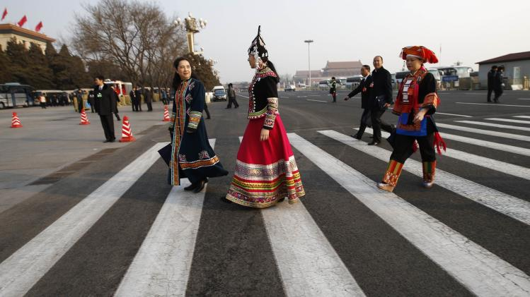 Ethnic minority delegates arrive at the Great Hall of the People prior to a plenary session of the National People's Congress in Beijing
