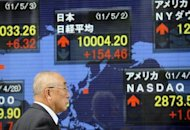 A businessman walks past an electric quotation board flashing the closing rates at the Tokyo Stock Exchange, in Tokyo on May 2. Europe's financial turmoil has seen the Chinese government quietly pour tens of billions of dollars into Japan's stock market, analysts say, despite the neighbours' lingering historical animosity