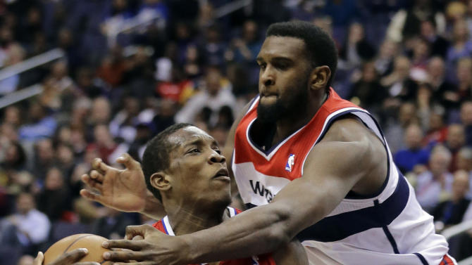 Los Angeles Clippers guard Eric Bledsoe (12) is fouled by Washington Wizards forward Chris Singleton (31) in the first half of an NBA basketball game Monday, Feb. 4, 2013 in Washington. (AP Photo/Alex Brandon)