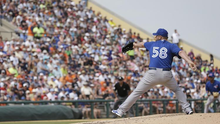 Toronto Blue Jays starting pitcher Todd Redmond throws during the third inning of a spring exhibition baseball game against the Detroit Tigers in Lakeland, Fla., Tuesday, March 11, 2014. (AP Photo/Carlos Osorio)
