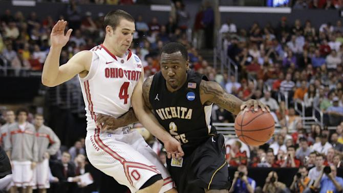 Wichita State guard Malcolm Armstead, right, works against Ohio State guard Aaron Craft (4) during the second half of the West Regional final in the NCAA men's college basketball tournament, Saturday, March 30, 2013, in Los Angeles. (AP Photo/Jae C. Hong)