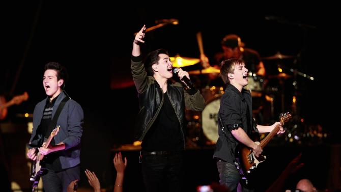 Members of the band Before You Exit perform during the 2014 iHeartRadio Music Festival in Las Vegas, Nevada