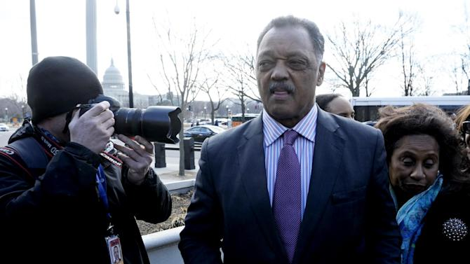 With the Capitol dome in the background, Rev. Jessie Jackson, Sr. and his wife Jacqueline Lavinia Brown arrive at federal court in Washington, Wednesday, Feb. 20, 2013, where their son, former Illinois Rep. Jessie Jackson, Jr., and his wife Sandra were to appear to answer criminal charges that they engaged in an alleged scheme to spend $750,000 in campaign funds on personal items.  (AP Photo/Cliff Owen)