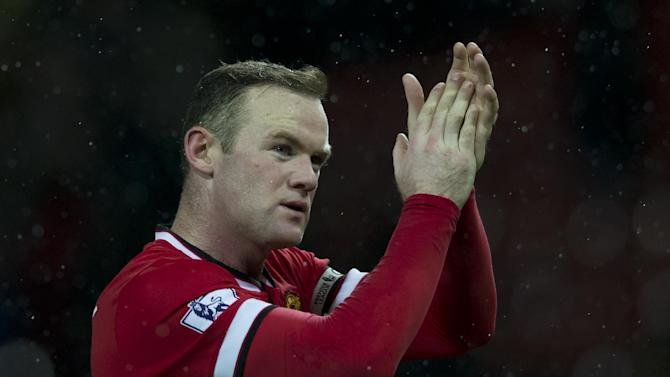 Manchester United's Wayne Rooney applauds supporters after the English Premier League soccer match between Manchester United and Newcastle at Old Trafford Stadium, Manchester, England, Sunday Dec. 26, 2014. (AP Photo/Jon Super)