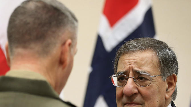 International Security Assistance Force (ISAF) Commander Gen. Joseph Dunford, left, speaks with outgoing U.S. Secretary of Defense Leon Panetta at NATO headquarters, Brussels, Thursday, Feb. 21, 2013. Panetta is in Brussels Thursday to attend a NATO Defense Ministers Meeting. (AP Photo/Chip Somodevilla, Pool)