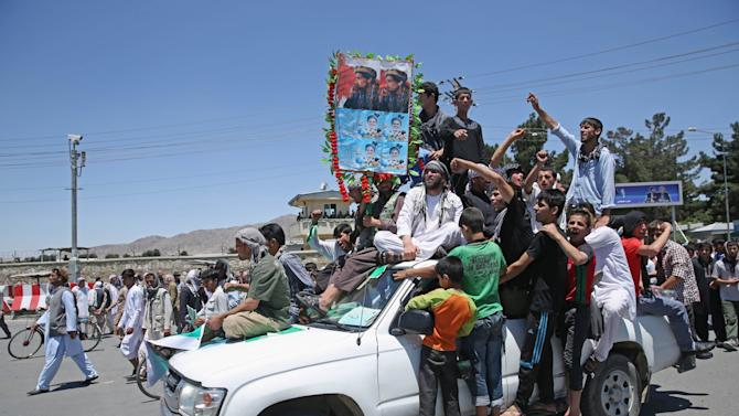 Supporters of presidential candidate Abdullah Abdullah shout slogans during a protest in Kabul, Afghanistan, Saturday, June 21, 2014. Former Foreign Minister Abdullah, who is running against Ashraf Ghani Ahmadzai, a former finance minister, has accused electoral officials and others of trying to rig the June 14 vote against him. (AP Photo/Massoud Hossaini)