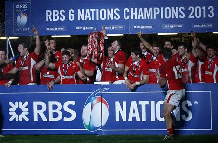 Wales' Gethin Jenkins holds aloft the Six Nations Trophy after defeating England in their international rugby union match at the Millennium Stadium in Cardiff