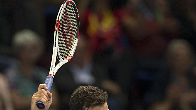 Bulgaria's Grigor Dimitrov looks on after playing a shot during the quarterfinal match against Switzerland's Roger Federer at the Swiss Indoors tennis tournament at the St. Jakobshalle in Basel, Switzerland, on Friday Oct. 24, 2014. (AP Photo/Keystone, Georgios Kefalas)