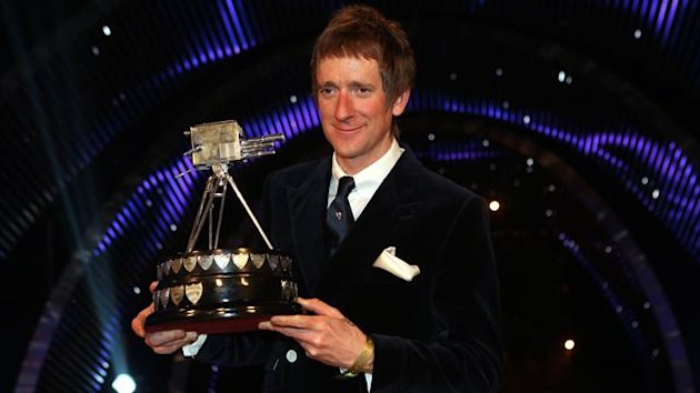 Wiggins with the SPOTY trophy (PA)
